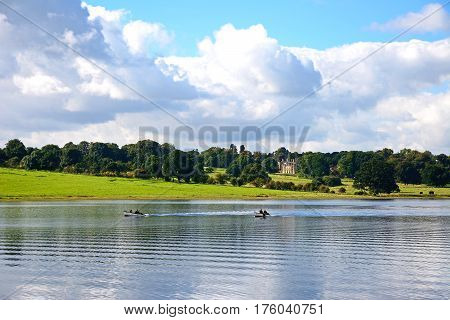 BLITHBURY, UNITED KINGDOM - OCTOBER 2, 2016 - View across Blithfield reservoir with a small boat to the left hand side Blithbury Staffordshire England UK, October 2, 2016.