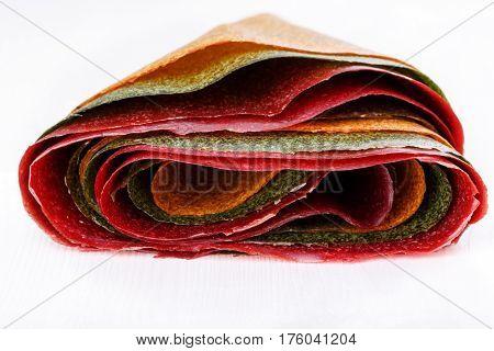 Tklapi - dried mashed fruit pulp / Colorful fruit leather from apricot kiwi dogwood. Georgian and Armenian cuisine.