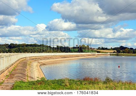 View across Blithfield reservoir with a road bridge to the left hand side Blithbury Staffordshire England UK.