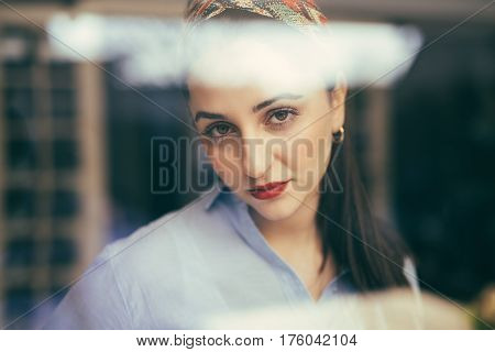 Woman With Emotionless Face Looking At Camera