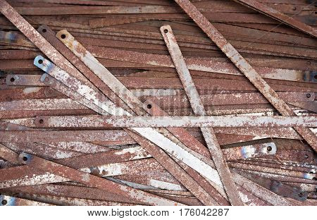 rusted old hacksaw blade on background ,