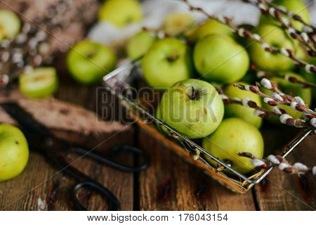Ripe Green Apples And Apple Slices On Wooden Gray Background, To