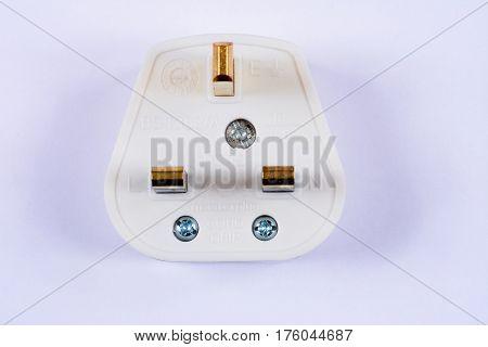 White English three pin plug against a white background UK.
