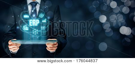 Enterprise resource planning ERP concept. Businessman work with ERP business management software for collect, store, manage and interpret business data about customers, HR, production, logistics, financials and marketing.