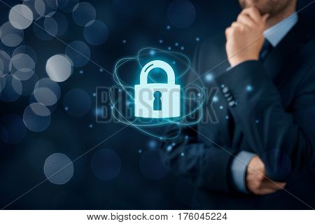 Businessman or IT specialist think about cybersecurity and information technology security services concept.