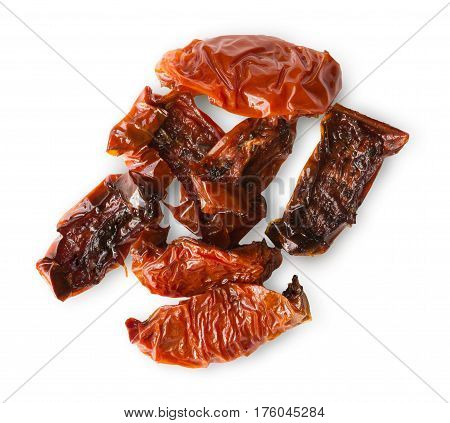 Dried tomatoes isolated on white background. Closeup image of cured vegetables, italian cuisine ingredient, healthy natural organic food