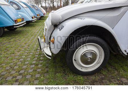 Utrecht Netherlands march 9 2017:: Colorful Vintage cars Citroen 2 CV named Duck on parking place Vechten next to motorway A12 in Holland
