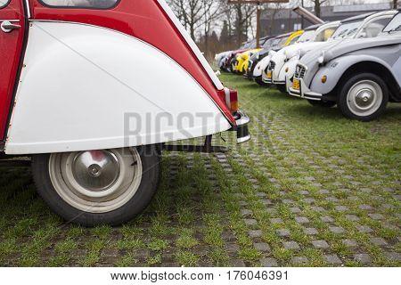 Utrecht Netherlands march 9 2017: Colorful Vintage cars Citroen 2 CV named Duck on parking place Vechten next to motorway A12 in Holland