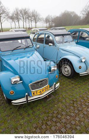 Utrecht Netherlands march 9 2017: BLue Vintage cars Citroen 2 CV named Duck on parking place Vechten next to motorway A12 in Holland
