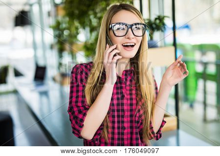 Freelancer Happy Woman Talking On The Mobile Phone With Office Buildings In The Background