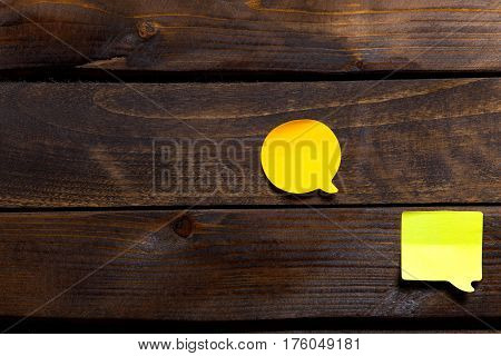 Two Yellow Stickers For Notes And Reminders On Wooden Background