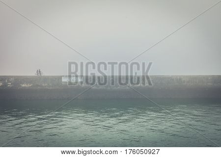 Fog on the pier of Les Sables d'Olonne (France) with two bicycles silhouettes