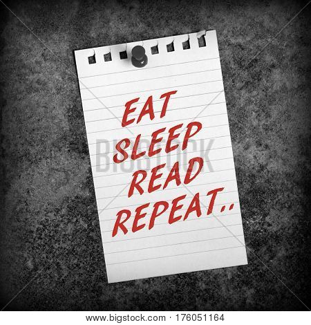 The words EAT, SLEEP, READ, REPEAT in red text on a piece of lined paper as a reminder of the preparation required when studying