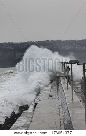 Big waves crashing on breakwater in Varna, Bulgaria