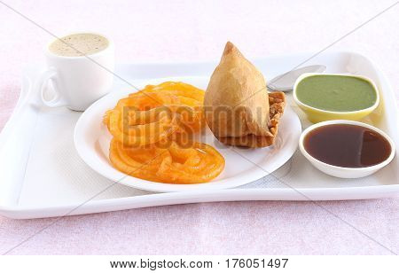Jalebi and samosa, Indian vegetarian food with their origins in north India, and coffee and chutneys.