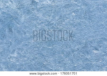 Abstract natural background - ice pattern on a water surface..