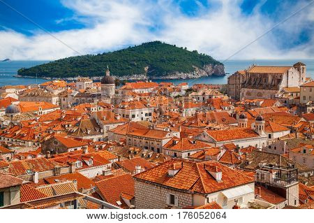 aerial view of the Dubrovnik Old town with its red roofs houses and island Lokrum in a background Croatia