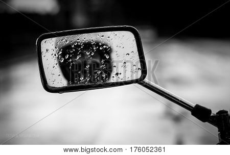 Raindrops On The Motorcycle Mirror.