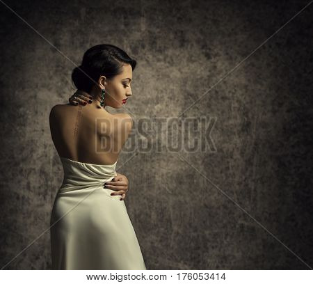 Fashion Model Back Elegant Woman in Sexy Dress Sensual Lady in Beauty Gown Rear View Posing over grunge background