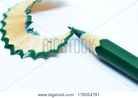 Sharpened Green Color Pencil And Wood Shavings