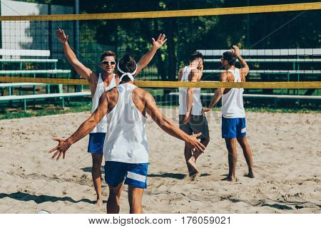 Beach volleyball Players won game, color image