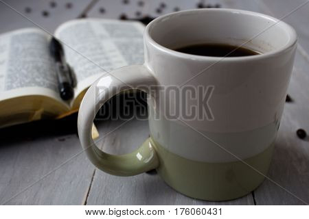 the Bible and coffee beans on board