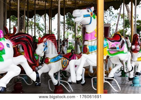 carousel. Horses on a carnival merry go round