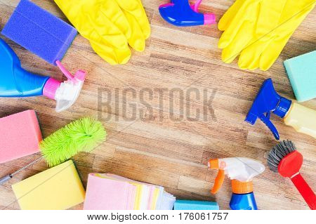 Spring cleaning concept - colorful sprays botles and rubbers frame