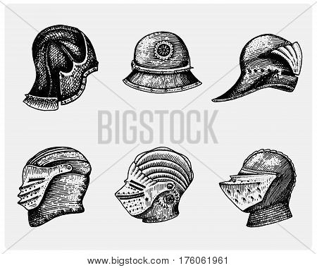 set of medieval symbols Battle Helmets for knights or kings, vintage, engraved hand drawn in sketch or wood cut style, old looking retro roman