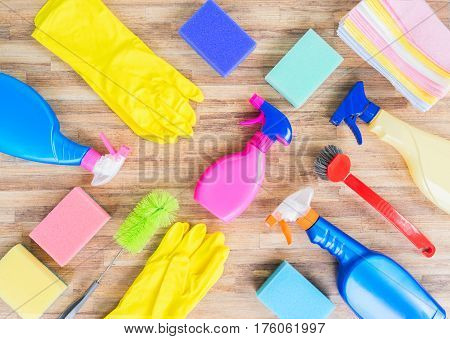 Spring cleaning concept - colorful sprays bottles and rubbers pattern