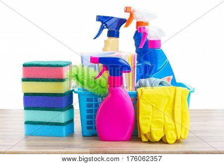 Spring cleaning concept - colorful sprays bottles and rubbers on wooden table border isolated on white background