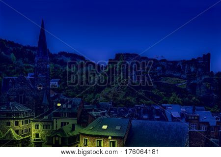 View of the Church and the Castle in the Belgian City of La Roche. View of the town centre below its medieval Castle in of La Roche at night.