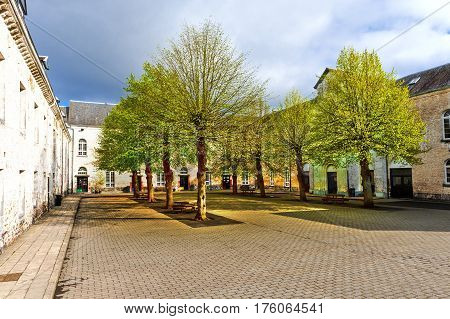 Patio of the Belgian house with park. The old pavement in St Hubert Belgium