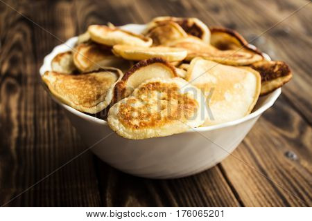 a homemade vegan pancackes bowl wooden background