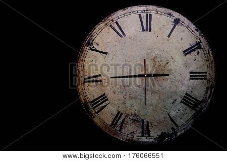 Old antique clock on a black background.