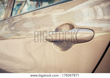 Abstract image of old car door handle. Macro shot.
