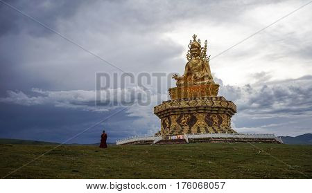 Big Buddha On The Grass Hill At Yarchen Gar
