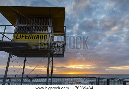 GOLD COAST, SURFERS PARADISE - MARCH 12 2017: Gold Coast lifeguard tower, located at Surfers Paradise. Taken on a cloudy sunrise