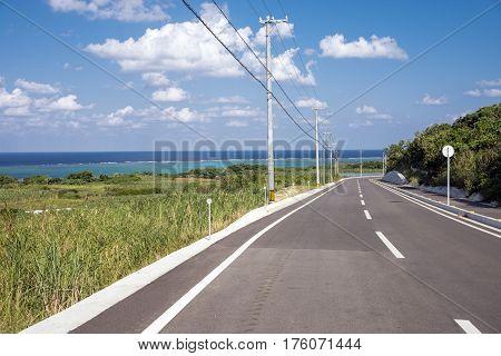 Country road near the sea under sky in Ishigaki island