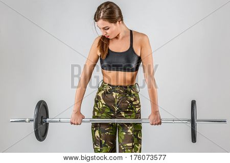 Female Soldier In The Gym Doing Exercises With Dumbbells