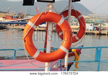 Ring buoy on the boat with the ocean