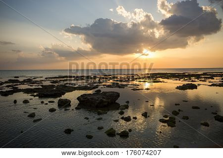 Lot of stone and rock rose out of the sea at evening in Senagajima, Okinawa
