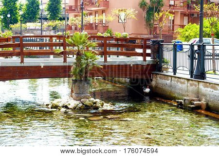 Pedestrian bridge across the river. City of Scafati Italy. Architecture of a small southern Italian town.