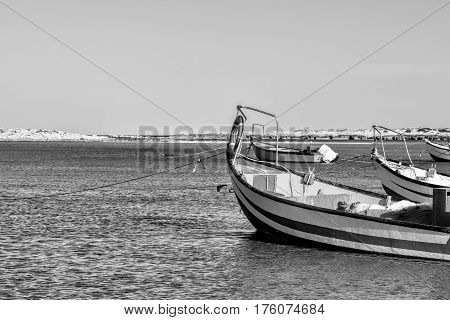 Small motor boats at the beach. Fishing Boats moored in the mediterranean sea in Israel. Black and White Picture