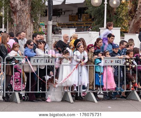 Viewers From Behind Dividing Fence Look At The сarnival Parade
