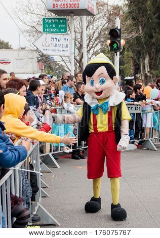 Participant In The сarnival Dressed As Pinocchio Goes Near  Viewers