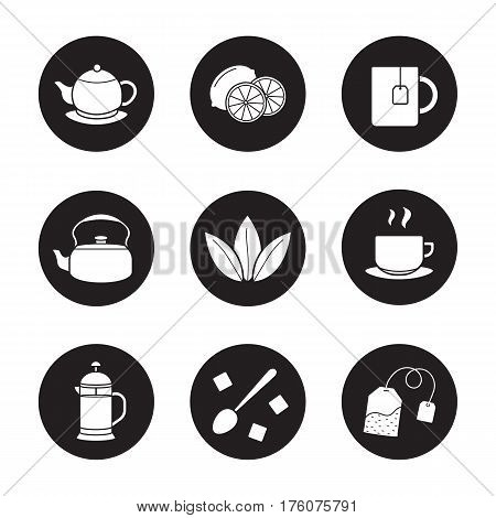 Tea icons set. Cutted lemon, steaming cup on plate, brewer, teapot, loose tea leaves, teabag, refined sugar cubes with spoon, kettle, mug. Vector white silhouettes illustrations in black circles