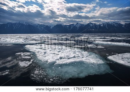 Large ice floe with blue underwater foundation north dramatic landscape