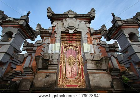 Door with ornament in the Indonesian temple at sunrise Bali