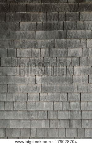 Neat. tidy. newer grey cedar shakes shingles background